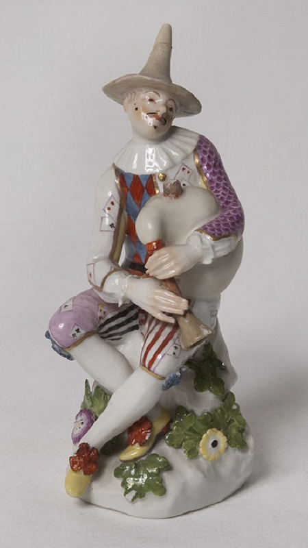 "Figurine, ""Harlequin blowing bagpipes"""